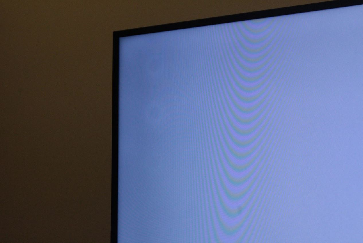 Small White Circles on TV screen - Samsung Community