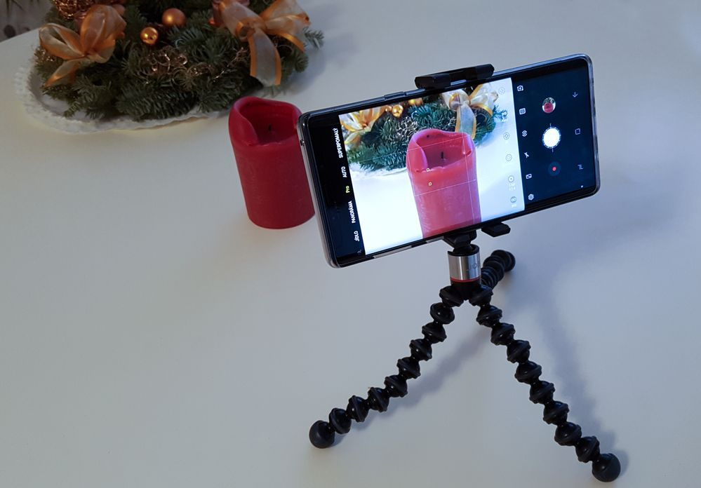 Simple tripod with mobile phone adapter